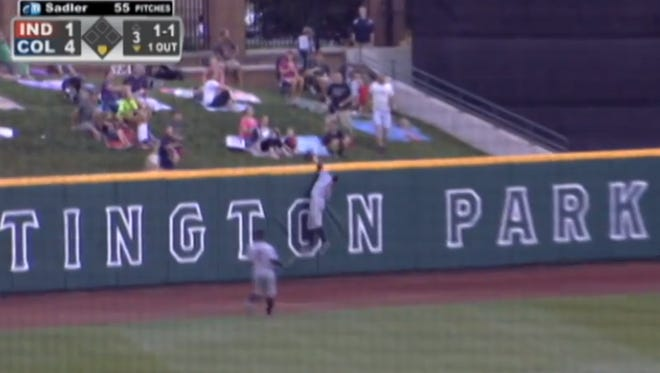 Chase d'Arnaud goes over the wall to make a leaping grab.
