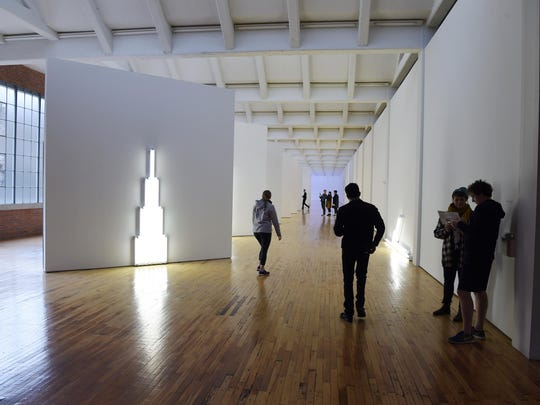 Visitors explore an art installation by artist Dan Flavin during the Dia:Beacon's Community Free Day in 2016. This year's event will be held Jan. 14.