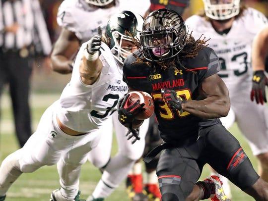 Michigan State linebacker Joe Bachie dives for Maryland