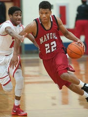 Manual's Dwayne Sutton, right, drives to the basket in a 2014 high school game.
