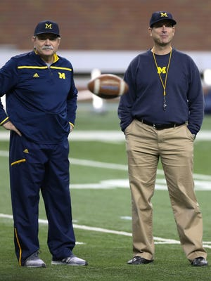 Michigan head coach Jim Harbaugh, right, and defensive coordinator Don Brown in March 2016.
