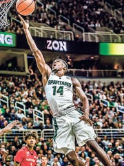 Eron Harris of MSU lays the ball in for 2 of his 14