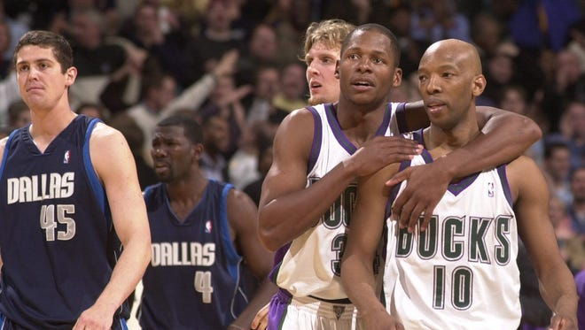 """Ray Allen embraces teammate Sam Cassell (#10) after the Milwaukee Bucks defeated the Dallas Mavericks in 2003. In his new memoir """"From the Outside,"""" Allen dishes on his years with the Bucks, including his conflict with coach George Karl."""