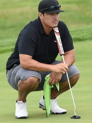 Mike Rivas, shown during first round play Saturday, had 18 holes to remember Sunday in the Men's City golf tournament.