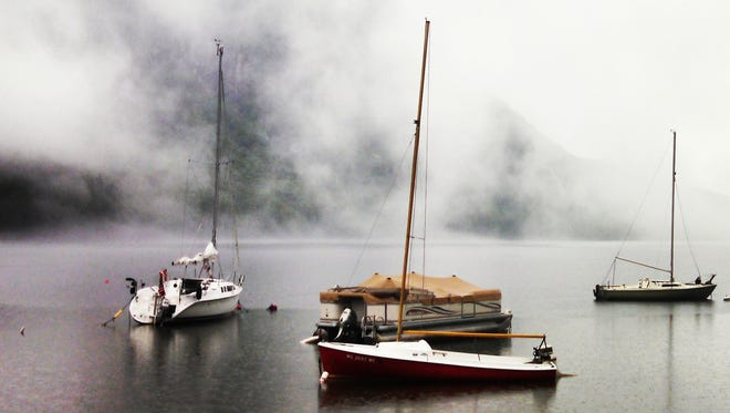 Sailboats moored in the mist on Lake Willoughby.