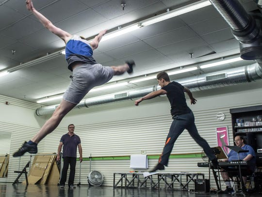 "Dancers Nick Raynor, left, and Davis Wayne rehearse for ""Pippin"" at the Dance Factory in Coldwater. The show opens Thursday as part of Tibbits Summer Theatre."