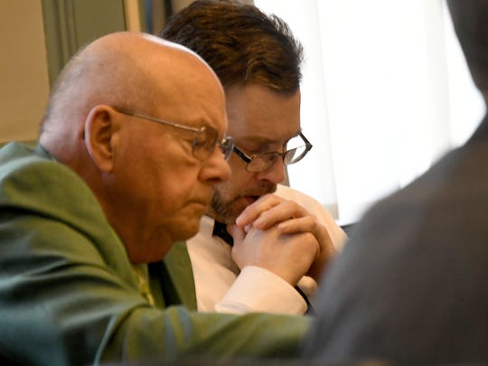 Accused killer shawn Grate and his attorney Robert Whitney listen to testimony Tuesday afternoon during Grate's murder trial in Ashland County Common Pleas court.