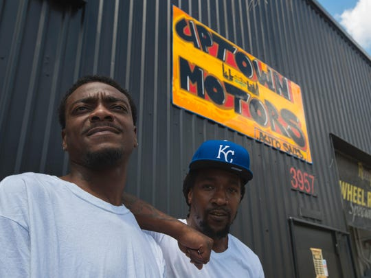 Former NFL player and Michigan State University star receiver Charles Rogers, left, poses for a portrait with childhood friend Melchizedek (Mel) Washington on Wednesday March 29, 2017. Rogers, who now lives in North Fort Myers, is an employee at Uptown Motors which is owned by his friend Washington.