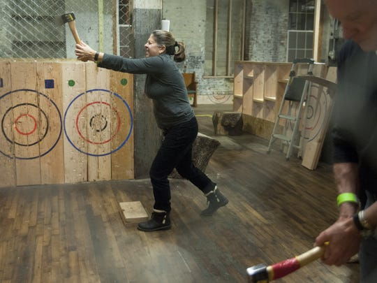 Lisa Mazzola, former Haddonfield resident now living in Philadelphia, eyes up the target as she prepares to throw an axe at Urban Axes in Philadelphia.