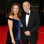 """Producers Barbara Broccoli and Michael G. Wilson pose for photographers upon arrival for the World Premiere of """"Spectre"""" at the Royal Albert Hall in central London."""