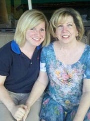 Sara Ellis, 29, left, of Seminole, Florida, was killed by a co-worker at the Pisgah Inn in July 2018, according to a Department of Justice grand jury indictment. She is seen here in a photo with her mother, Jamie.