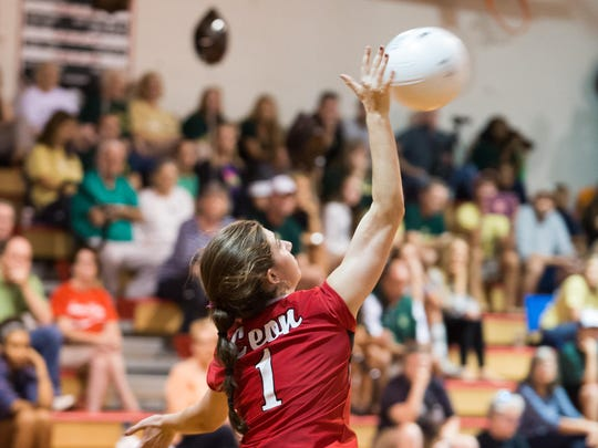 Leon senior Elyse Thompson serves during a regional semifinal match against Lincoln. Thompson had 15 digs from her libero position.