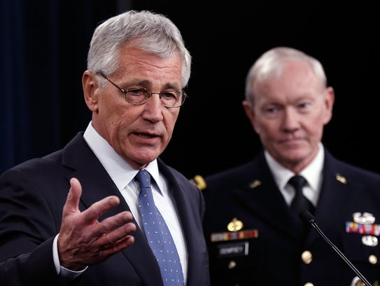 ARLINGTON, VA - FEBRUARY 24:  U.S. Secretary of Defense Chuck Hagel (L) and Chairman of the Joint Chiefs of Staff Gen. Martin Dempsey (R) answer questions during a press conference at the Pentagon February 24, 2014 in Arlington, Virginia. Hagel and Dempsey spoke about the upcoming Defense Department budget requests during the press conference. A proposal released February 24, plans to shrink the U.S. Army to pre-World War II levels.   (Photo by Win McNamee/Getty Images)