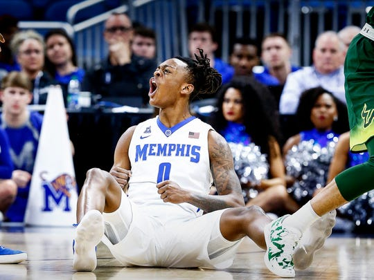 Memphis forward Kyvon Davenport celebrates a USF tournover during first half action of their AAC first round conference tournament game in Orlando, Fl., Thursday, March 8, 2018.