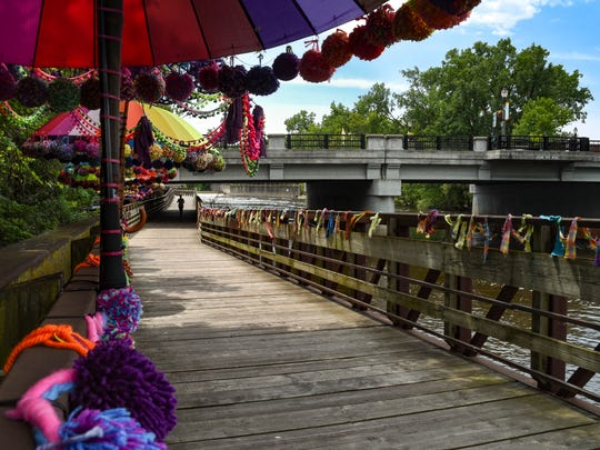 """An installation along the Lansing River Trail in Old Town by Lansing-based fiber artist Jane Reiter entitled """"Follow Your Bliss,"""" as seen Friday, June 8, 2018."""