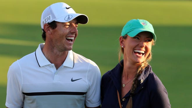 Rory McIlroy of Northern Ireland celebrates with his girlfriend Erica Stoll after his win on Nov. 22, 2015 in Dubai, United Arab Emirates.