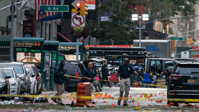Crime scene investigators work Sunday, Sept. 18, 2016, at the scene of Saturday's explosion in Manhattan's Chelsea neighborhood, in New York.
