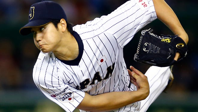 In this Nov. 19, 2015, file photo, Japan's starter Shohei Otani pitches against South Korea during the first inning of their semifinal game at the Premier12 world baseball tournament at Tokyo Dome in Tokyo.
