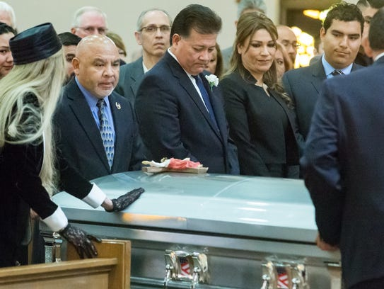 Las Cruces Mayor Ken Miyagishima, center, places his hand on the casket of his father Mike Kazuji Miyagishima, at the Cathedral of the Immaculate Heart of Mary on Saturday March 17, 2018.