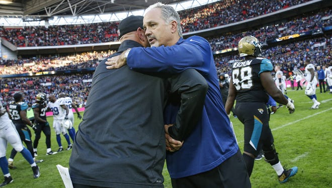 Indianapolis Colts head coach Chuck Pagano hugs Jacksonville Jaguars head coach Gus Bradley on the field after the game at Wembley Stadium in London on Oct. 2, 2016.