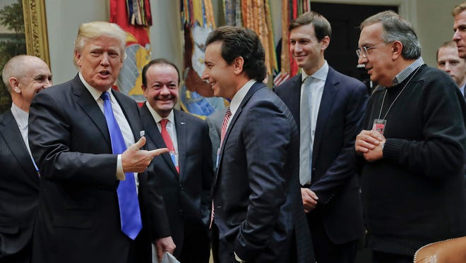 President Trump points to Ford Motors CEO Mark Fields, center, at the start of a meeting with automobile leaders at the White House on Jan. 24, 2017. Also at the meeting were Fiat Chrysler Automobiles CEO Sergio Marchionne, right, and White House Senior Adviser Jared Kushner, second from right.