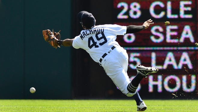 Tigers' Dixon Machado can't reach the ball during the sixth inning against the Twins, Sept. 24, 2017 in Detroit.