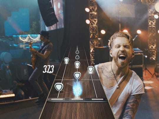 "Guitar Hero Live replaces the cartoony presentation of past games with a more  live"" feel."