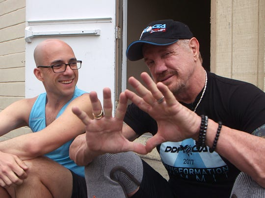 Asbury Park Press features reporter Alex Biese (left) talks with Diamond Dallas Page about his DDP Yoga program on April 30 in Union.