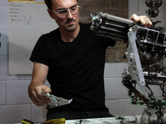 "Jeremy Mayer sculpts with parts of typewriters in ""California"