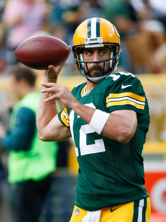 FILE - In this Aug. 10, 2017, file photo, Green Bay Packers' Aaron Rodgers warms up before a preseason NFL football game against the Philadelphia Eagles, in Green Bay, Wis. Green Bay Packers  tight end Martellus Bennett is confident he'll do just fine connecting with Aaron Rodgers, even if the veterans might get limited reps together in preseason games. (AP Photo/Mike Roemer, File)