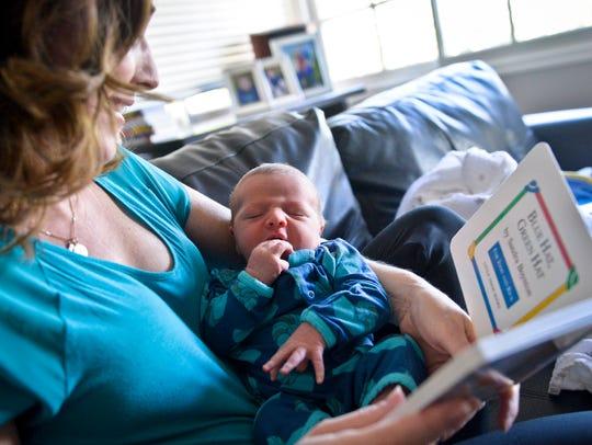Dr. Tanya Altmann, left, holds her newborn son, Maxton,