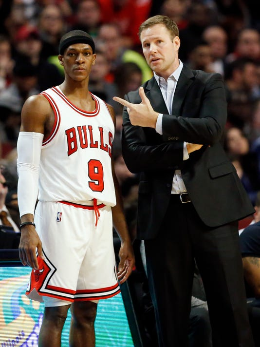 Chicago Bulls head coach Fred Hoiberg, right, talks with guard Rajon Rondo during the second half of an NBA basketball game against the Miami Heat, Saturday, Dec. 10, 2016, in Chicago. The Bulls won 105-100. (AP Photo/Nam Y. Huh)