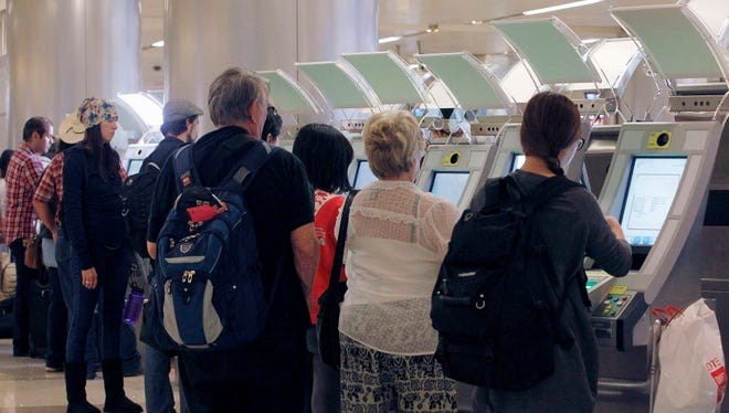 Passengers arriving from abroad at Los Angeles International Airport use new automated passport kiosks Sept 24, 2014.