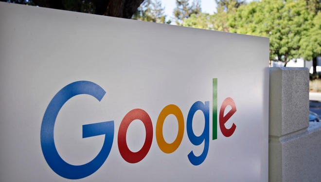 FILE - This Oct. 20, 2015, file photo, shows a sign outside Google headquarters in Mountain View, Calif. Google unveils its vision for phones, cars, virtual reality and more during its annual conference for software developers, beginning Wednesday, May 18, 2016. (AP Photo/Marcio Jose Sanchez, File)