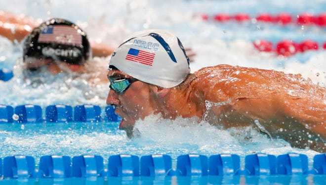 Ryan Lochte, back, and Michael Phelps swim during the men's 200-meter individual medley final during the U.S. Olympic swimming team trials at CenturyLink Center.