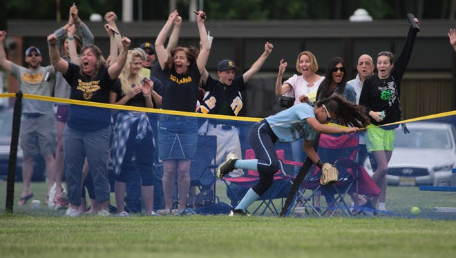 Ramsey fans celebrate as Victoria Sebastian's home run clears the fence in the second inning.