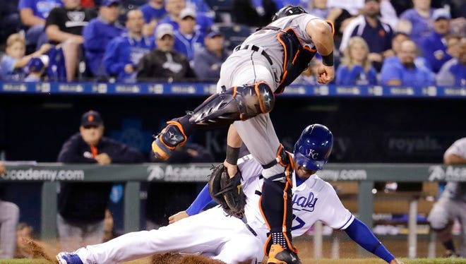 Kansas City Royals' Raul Mondesi is tagged out by Detroit Tigers catcher James McCann during the eighth inning Wednesday. The Royals won 7-4.