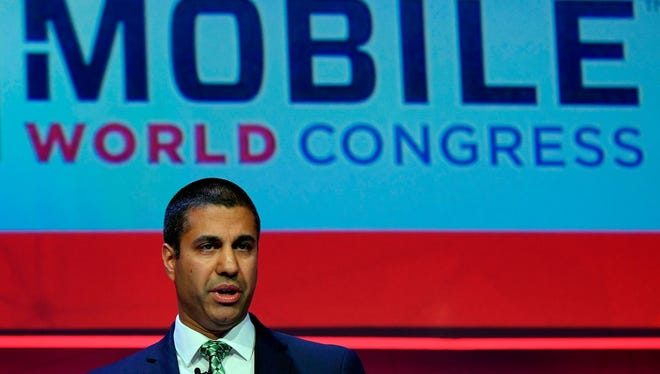 Chairman of the USA Federal Communications Commission, US telecommunications director Ajit Pai, gives a press conference on the first day of the Mobile World Congress (MWC) on February 26, 2018 in Barcelona.