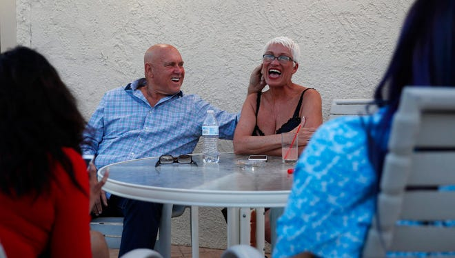 In this April 27, 2018, photo, owner Dennis Hof, left, jokes with madam Sonja Bandolik at the Love Ranch brothel in Crystal, Nev. A coalition of religious groups and anti-sex trafficking activists have launched referendums to ban brothels in two of Nevada's seven counties where they legally operate. Hof, a legal pimp challenging an incumbent Republican lawmaker Tuesday, June 12, says a push to ban legal brothels is political retribution. (AP Photo/John Locher)