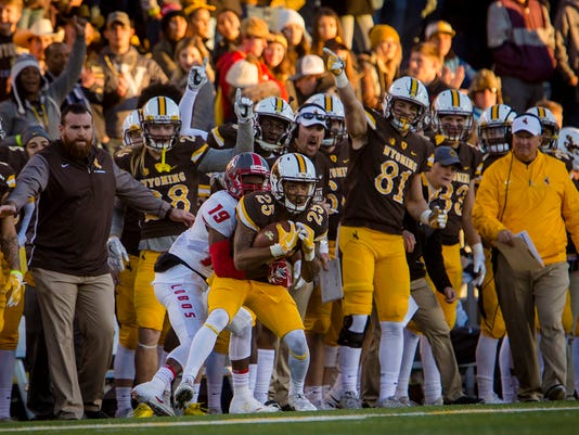 Wyoming wide receiver Austin Conway (25) catches the ball near the sidelines as New Mexico running back Bobby Cole (19) comes in for a tackle during an NCAA college football game Saturday, Oct. 28, 2017, in Laramie, Wyo. (Josh Galemore/The Casper Star-Tribune via AP)