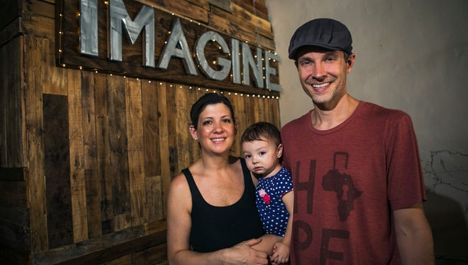 """July 7, 2017 - Kristie, 35, and Adam Jeffrey, 40, pose for a photo with their 22-month-old daughter Aspen in their Cooper Young restaurant, Imagine Vegan Cafe, on Friday. Kristie spoke out against a social media critic who complained the couple allowed Aspen to run naked in the restaurant. """"We have learned that you've gotta have fun with this stuff, especially the fake websites and stuff,"""" said Kristie, who's been in the restaurant industry for six years. """"And have humor with it because this can get you down really fast, but just embrace it and have fun. The people that are going to support you will support you and the people that are just out to get on the bandwagon or to show the hate, they won't support you and that's okay. We don't need their money anyway."""""""