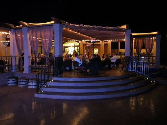 Guests sit on the outdoor patio at Heart of the Desert