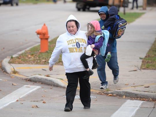 Crossing Monroe Avenue outside Aldo Leopold Community