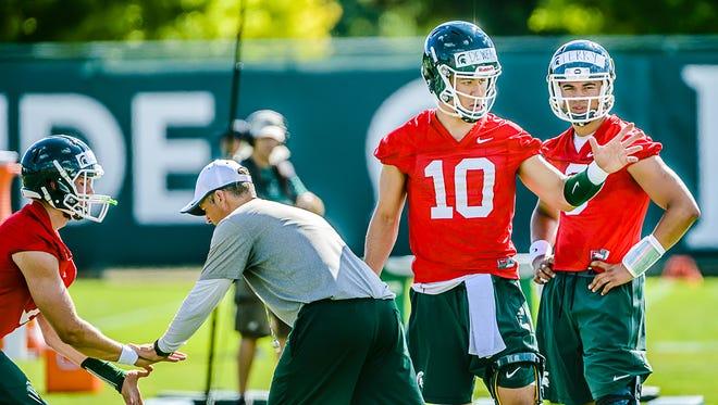 MSU quarterback Messiah deWeaver (10) goes through a practice drill Saturday, Aug. 6, 2016, in East Lansing.