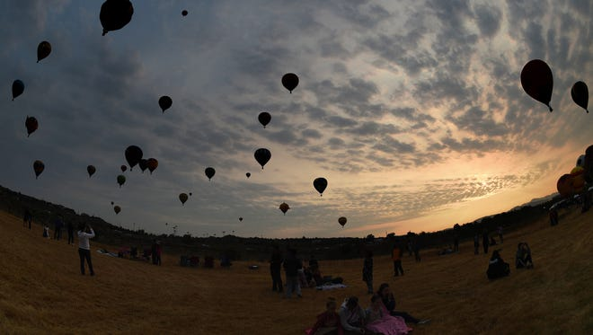 People attend the Great Reno Balloon Race at San Rafael Regional Park in Reno on Saturday morning,  Sept. 12, 2015.