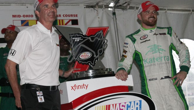 Mid-Ohio Sports Car Course President Craig Rust poses with Justin Marks during the victory celebration after the end of the Xfinity Series Mid-Ohio Challenge.