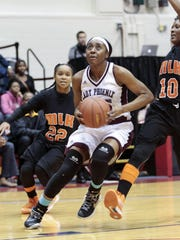 Detroit Renaissance's Siyeh Frazier drives to the hoop against Detroit King in the PSL championship Feb. 19 at Calihan Hall. Frazier scored 37 points in a 68-66 loss.