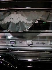 In this July 15, 2016 photo, the casket of Alton Sterling is placed into a glass covered hearse following his funeral service in Baton Rouge, La.