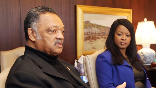 Rev. Jesse Jackson and state Rep. Alicia Reece, D-Roselawn, met with Enquirer editors and reporters last year to discuss voting rights.