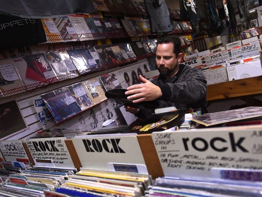 Chris Fuqua shops during a Black Friday sale at Recycled Records in Reno on Nov. 27, 2015.